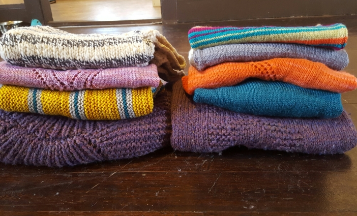 Collection of hand knit sweaters